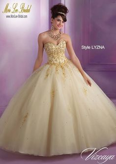 Style LYZNA Embroidered Tulle Quinceanera Gown with Beading  Bolero Jacket. Corset Tie Back. Colors Available: Stiletto/Gold, Deep Purple/Gold, Champagne/Gold, White/Gold. Sizes Available: 0-24.  Precio : $2.645.500 Pesos Colombianos Precio : $ 1,202.00 Dolares Americanos