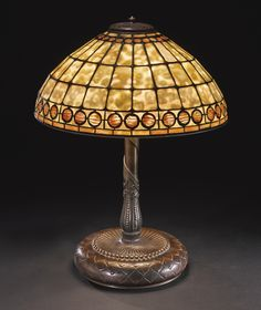 "** Tiffany Studios New York ""Geometric"" leaded glass and patinated bronze table lamp."