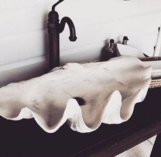 If you are a mermaid, exiled to live in the city, this shell sink might be what you have been longing for. To avoid the kooky aunt style, avoid coming up with more ways to squeeze shells into your bathroom, keep it simple! More shell sinks here: https://www.conchking.com/Giant-Clams2.htm #ilovebathroomideas #inspiration #dreamhouse #apartmenttherapy #interiorinspiration #liveauthentic #giftideas #bathroompics
