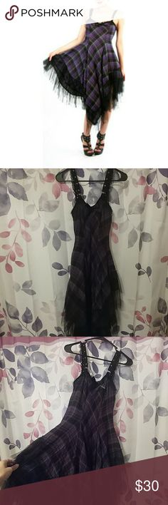 Lip Service Purple Plaid flowy dress Adorable purple plaid dress with asymmetricly skirting, netting trimming on the skirt, and pockets! Great condition, no rips tears or stains. Runs big in size. Is tagged as an extra small but really fits a small. Lip Service Dresses Asymmetrical