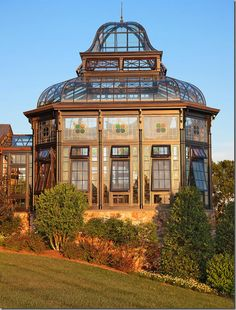 This beautiful antique-style greenhouse is the star at the end of this home.   Tanglewood Conservatories, Denton, MD