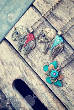 Love these elephant necklaces!