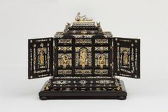 Cabinet. Artist: Ulrich, Boas (1550 - 1624). Date: 1605-1610. Ebony with silver and silver gilt mounts, cast, pierced and chased. Height: 38 cm, Width: 36.8 cm, Depth: 29.3 cm. -Victoria and Albert Museum-