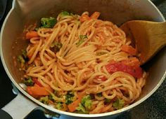 This is pasta I made for my brother and I for lunch, and this isn't my first time cooking and baking, but the first time I've ever made pasta! XDD   INGREDIENTS: Angel Hair pasta Tomato Herb pasta sauce Four Cheese  Tuscan-style frozen veggies   It's simple, and you can tell I've thrown everything in the pot! :P