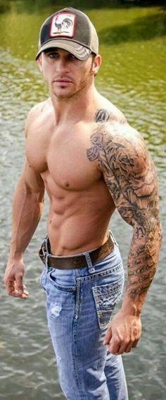 DAMN! He fine oh n bad ass tattoo