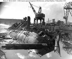 Pearl Harbor Attack, 7 December 1941    USS Cassin (DD-372) burned out and capsized against USS Downes (DD-375)