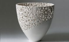 The intricate correlation between the tangled lines and the smooth surface make this vase intriguing and delightful!