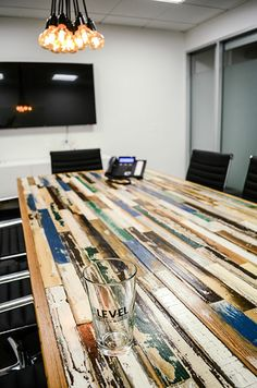 Conference room table from reclaimed wood .