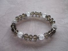 Buy Grey quartz faceted rondelle bracelet by shynnasplace. Explore more products on http://shynnasplace.etsy.com