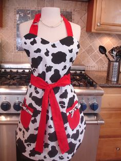 """Retro Apron - Vintage Inspired Cow Print with Red Ties  - Reversible Apron for Women. $33.00, via Etsy.  I can hear it now, """"Does this apron make me look like a cow?""""       KH"""
