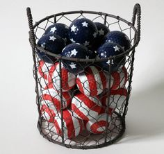 We used old golf balls and up-cycled them into cool patriotic holiday decor. These Patriotic Flag Painted Golf Balls are a perfect centerpiece for the summer holidays!
