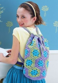 Floral Hexagon Bag    By: Ellen K. Gormley for Red Heart Yarn    Join up colorful hexagon and pentagon granny squares in this summer bag crochet pattern. The crochet motifs have a floral appearance appropriate for spring and summer.