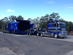 You know when you have cool customers when they paint a 110 cubic metre bucket your fleet colours to match the truck combo !   Load is 8.5m wide and 5.8m high loaded heading to Central Queensland to dig a big hole.