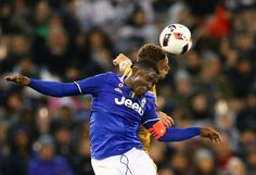 Kieran Trippier of Tottenham Hotspur and .Alex Sandro of Juventus FC compete for the ball during the 2016 International Champions Cup match between Juventus FC and Tottenham Hotspur at Melbourne Cricket Ground on July 26, 2016 in Melbourne, Australia.
