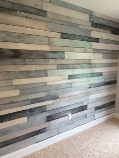 Pallet wood wall using Benjamin Moore Metallic paint -silver and charcoal, in addition three different latex based paints in various shades of gray. Once boards were painted, we painted a quick coat of Benjamin Moore metallic glaze pearlescent over (except for the silver color).