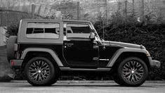 Black 2-door Jeep Wrangler