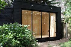 Contemporary garden office in black cladding and birch plyinterior