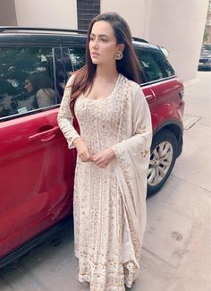 Actress Sana Khan spotted in a Talking Threads deep ivory gold chikankari anarkali suit with zardozi and kani detailing Pakistani Fashion Casual, Indian Fashion Dresses, Dress Indian Style, Indian Outfits, Indian Attire, Indian Ethnic Wear, Simple Kurta Designs, Bridal Lehenga Collection, Pakistani Formal Dresses