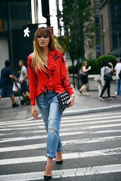 red skull print blouse with casual jeans