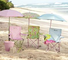 Pastel deckchairs and umbrellas on the beach
