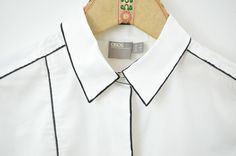 White Shirt Refresh: 7 Stylish Clothing Hacks For a Basic Button Down