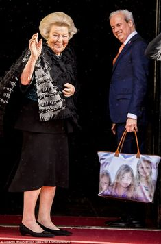 Princess Beatrix of the Netherlands was spotted with a tote printed with the faces of three of her granddaughters as she arrived at a reception at the Royal Palace of Amsterdam