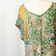 """Striking Green Paisley Print Chiffon Blouse Sexy without trying! Green chiffon Paisley print with yellow plum white and berry accents. Faux front button closure, extended drop sleeves, open slit back. Drapes beautifully!   100% poly. Dry clean.  Made in USA   50"""" bust 24""""overall length Tops Blouses"""