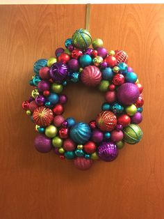 2014 ornament wreath. Ornaments hot glued to deco mesh that was wrapped and hot glued around a straw wreath. They didn't have any foam ones expect for piddly flat things.