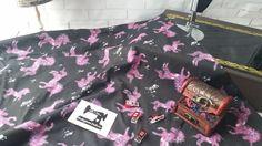 Pink unicorns on black 95/5 cotton lycra 4 way stretch knit fabric