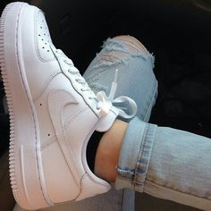 white nike air force one shoes ✓ black no-show socks ✓ light-wash ripped jeans