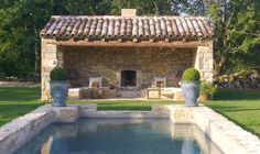 Lovely pool house and stone edge around pool