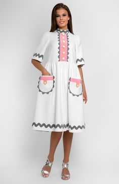 White boxy cotton dress decorated with ribbon. Band collar. Hidden back zip closure. Patch pockets.