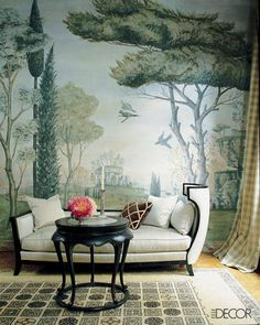 a silk-upholstered daybed provides a luxe spot to take in the muraled art + intricate tiling