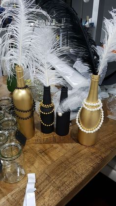 Handmade deco for Gatsby themed baby shower. Recycled wine bottles spray painte Handmade deco for Gatsby themed baby shower. Roaring 20s Birthday Party, Great Gatsby Themed Party, Great Gatsby Party Decorations, Black And Gold Party Decorations, Handmade Decorations, Roaring 20s Theme, Masquerade Party Decorations, Black Gold Party, 25th Birthday