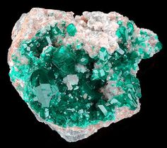 Dioptase crystals on calcite crystals. Source: Tsumeb, Namibia.
