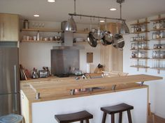 Nice use of space above island. Additional raised counter space at stools. Jars and war shelving is nice (maybe easily bumped into). Maximize Space, Counter Space, Decorating Small Spaces, Prefab, Places To Eat, Building A House, Building Ideas, Kitchen Dining, Shelving