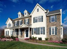 A stone and white exterior: Timeless style in a newly built home. The Washington plan in The Vineyards community by Hallmark Homes Group. Breinigsville, PA.