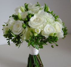 Wendy's bouquet of Roses Avalanche and Akito, freesia, pale green ...