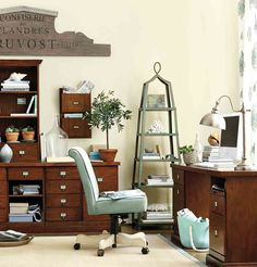 Especially in home office spaces, it's important to go vertical with your storage pieces, like an etagere, wall mounted pockets, and a hutch!