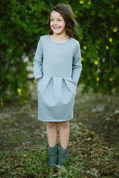 Children's Sewing Patterns, This Audrey pattern features pockets, pleated front and two sleeve length options. This modern dress requires no button holes, shirring or zippers. All pattern pieces are included- no measurements.