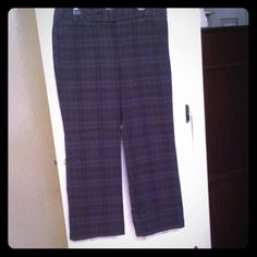 "Tommy Hilfiger plaid dress pants Charcoal gray/ navy blue and black Tommy Hilfiger plaid dress pants.  Slim trouser leg. Perfect for work or a nice dinner. 77% cotton 21% polyester 2% spandex. Inseam 29 1/4"" Minimal signs of wear. Tommy Hilfiger Pants"
