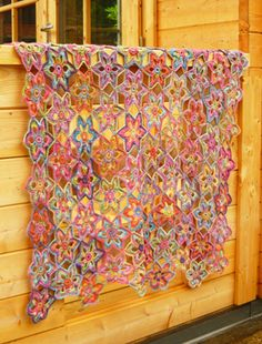 Crochet lily blanket..thinking making this narrower as use it as a spring time table runner !