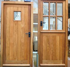 "Pair of oak doors, one as a stable door and one with small viewing panel, both with Jim Lawrence ""Shepherd's Crook"" handles"