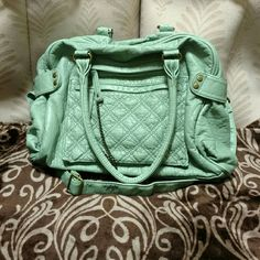 UO Kimchi Blue Purse Seafoam green purse from Urban Outfitters. It has a removable long strap, 2 pockets in the front, and 1 pocket inside. The color is most like the first pic. I rarely used it, it's still in good condition. Kimchi Blue Bags