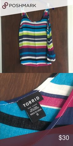 Torrid Striped Georgette tank top Torrid 0X striped georgette tank top. Only worn once or twice. In great condition, but there is a section on one of the blue stripes that has had different stitching and was like that when I bought it in Torrid. torrid Tops Tank Tops