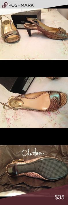 "Cole Haan snake sling back Tan/gold snakeskin with gold tone buckle. 2 3/4 "" heel. Like new with dust bag and box. Small smudge on left buckle. See last photo. PRICE IS FIRM. Cole Haan Shoes Heels"