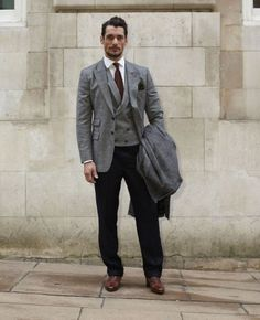 """David Gandy. The model and British Fashion Council Ambassador, who this week announced he is to work to further fashion's involvement in comic relief, hit the shows on Monday wearing his own jacket, waistcoat and trousers produced in collaboration with Neil Fennell. The tie is from Riess, shirt from Thomas Pink and shoes from Russell & Bromley. """"So it's all British"""", he emphasised. """"And my coat today is from M'S new Great British collection. The only thing I never wear by choice is trainers…"""