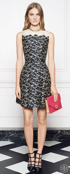 Accessorize eveningwear elegance with a bright clutch for a pop of color | Tory Burch Holiday 2014
