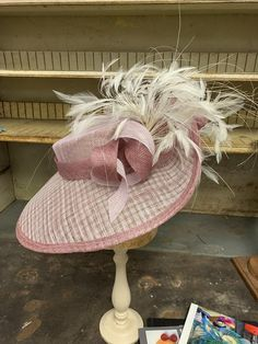 This blushing lady is perfect for Kentucky Oaks day at the derby. Two tones of blush pink sinamay with a cheeky layer of ivory lattice sinamay, are blocked over wooden hat blocks to create its unique shape. The brim has a lovely little pleat that helps ivory feathers spill around the hat and is tied Fascinator, Headpiece, Can Makeup, Oaks Day, Hat Blocks, Cocktail Hat, Wide-brim Hat, Derby Hats, Kentucky Derby