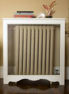 A radiator cover is essentially just a 3-sided box. Create openings to radiate the heat out of the cover. If you are worried about losing heat because of the cover, slip a sheet of metal behind the radiator to reflect heat out into the room.
